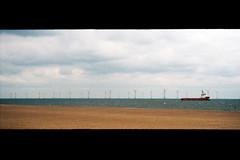(Delay Tactics) Tags: sea side coast beach sand sky wind farm windmills boat trawler ship horizon panorama clouds renewable energy great yarmouth