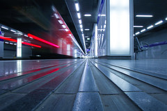 Missed (CoolMcFlash) Tags: train station vienna dynamic dynamisch motion blur speed longexposure leadingline vanishingpoint modern lines dynamik architecture tactilepaving lowangleview perspective pov pointofview canon eos 60d zug wien bewegung bewegungsunschrfe lighttrail lichtspur geschwindigkeit linien fluchtpunkt architektur blickwinkel perspektive fotografie photography sigma 1020mm 35 wienmitte reflection spiegelung