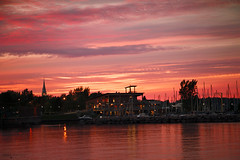 Roberval - Lac Saint Jean (Qubec, Canada) (Andrea Moscato) Tags: andreamoscato canada america sunset tramonto sky cielo silhouette lago lake water freshwater structure architecture marina harbor clouds nuvole dark shadow light reflection riflesso ombre red yellow landscape paesaggio view vista vivid city citt porto evening