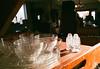 Lit Glassware (Georgie_grrl) Tags: princeedwardcounty cottagechoir friendship music social friends roadtrip pentaxk1000 rikenon12828mm ontario antiques store deadpeoplesstuffantiques bloomfield glassware saltandpeppershakers plates cups
