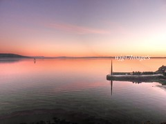 Sunset on Lough Foyle. (willieguildea) Tags: sun sunset sky water watercsape lough river loughfoyle ulster eire ireland donegal moville harbour pier outdoor landscape irishsunset shore shoreline coast coastal seaside nikon