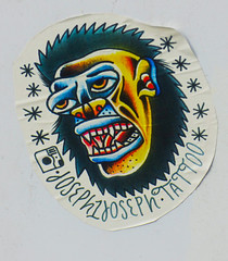 Joseph Tattoo (Steve Taylor (Photography)) Tags: joseph tattoo animal monster yeti art graffiti drawing pasteup wheatup wheatpaste streetart colourful black blue white yellow red stark eerie scary frightening odd crazy weird paper newzealand nz southisland canterbury christchurch city cbd