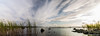 Escaping clouds (K3ndu) Tags: blue sky panorama sun birds animals fauna clouds canon cormorants eos dc seaside rocks long exposure estonia sigma cormorant welcome overexposure 1770 waterside kuressaare escaping saaremaa panoraam welcometoestonia 1100d