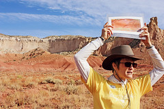Georgia O'Keeffe Country Tour Guide (K. Sawyer Photography) Tags: portrait woman mountains hat sunglasses painting landscape tour picture change differences changes comparison compare rockformations tourguide ghostranch walkingtour archaeologicalsite georgiaokeeffe abiquiunewmexico ghostranchnewmexico georgiaokeeffecountry ghostranchabiquiu walkingeorgiaokeeffesfootsteps walkinokeeffesfootsteps 280privatedrive