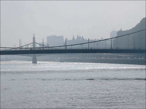 Magical morning view of Danube with bridge silhouettes, Budapest