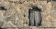 Windowsill (Ramon Quaedvlieg Photo) Tags: windowsill greece crete abandoned rocks travel outdoor wood old architecture building street wall mediterranean decay shutters hinge vamos