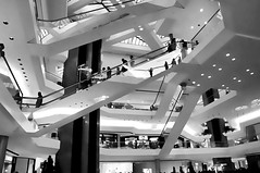 The Mall (floralgal) Tags: shopping themall shoppingmall modernarchitecture escalaters peopleonescelators peopleshopping thestamfordtowncenter stamfordconnecticutshoppingmall blackandwhiteshoppingmall modernarchitectureinblackandwhite linesandlevels