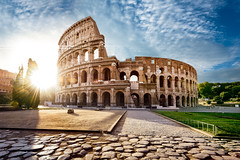 Colosseum in Rome and morning sun, Italy (beatricepreve) Tags: rome colosseum coliseum roman forum monument italian summer colosseo building dawn ancient way empire brick historical stone flavian theater italy sunrise past day archeology province european arc landmark field culture gladiator history shadow grass old historic stage round famous architecture blue ruin arena sunset stadium sky roma amphitheater exterior europe