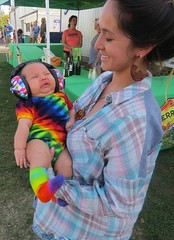 Baby Halloween Festival Dayglow (moonjazz) Tags: baby costume hippie mom love infant color earphones festival adorable photography caring protection ears dayglow socks cute hugs parents tiedye outfit halloween music smiles sleep childhood sweet fun humor tender perfect child clothes heath hearing wise new portrait blue pink green yellow rainbow