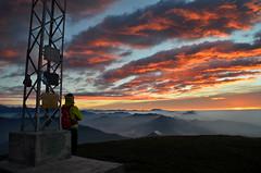 Albeggiando (Saramanzinali) Tags: alba sunset sole sun clouds cloudy nuvole colori colours mountains montagne camminare linzone bergamo valle imagna foschia fog person persona escursionista orobie