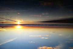 tesnuS (paulissimosousa) Tags: sunset inverted reflection sea sky clouds beach praiadabarra aveiro portugal