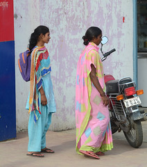 Indian women on street wearing traditional sari (phuong.sg@gmail.com) Tags: world poverty life street city houses people urban india girl beauty wall work buildings shopping walking outside living town community women colorful asia exterior dress outdoor delhi indian traditional crowd poor young culture lifestyle neighborhood sidewalk growth messy bombay population neighbors hindu society slums overcrowded