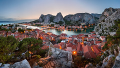 Aerial View of Omis Old Town and Cetina River Gorge, Dalmatia, Croatia (ansharphoto) Tags: road old city travel bridge roof sea sky urban panorama cliff house mountains building tree castle history water rock electric skyline architecture night river landscape lights evening harbor town twilight europe mediterranean european cityscape village fort dusk croatia landmark canyon medieval illuminated resort gorge iconic vacations adriatic dalmatia cetina omis