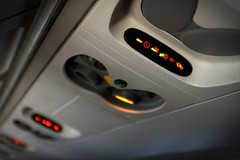 Locked and loaded for landing. (Jamie McCaffrey) Tags: sign airplane signage nosmoking seatbelt fastenseatbelt