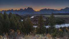 Snake River A Runnin (Luis Arturo Ramirez) Tags: lighting sunset usa mountain color pine river landscape rockies outdoors twilight exposure glow snake famous snakeriver wyoming wilderness alpen grandteton grandtetonnationalpark luisramirez