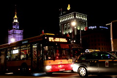 A walk in the night; pause to take a picture (Giangaleazzo) Tags: street city bus tower car night canon eos lights europe strada cityscape traffic taxi transport poland warsaw autobus luce polonia traffico varsavia 40d