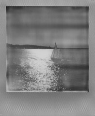 Presque Isle Bay Lake Erie (The Stugots) Tags: sx70 sx 70 impossible project film black white bnw bw silver frame instant roidweek polaroid week polaroidweek lake view bay front water erie presque isle expired photography snapitseeit sail boat boats pennsylvania