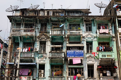 Old residential building in Yangon, Myanmar (phuong.sg@gmail.com) Tags: antenna apartment architectural architecture asia asian balcony block blue building burma city cityscape colonial colorful contemporary culture destination dirty door europe european exterior facade famous french history home house landmark myanmar old rangoon residential roof satellite sky slum structure tourism travel urban window yangon yellow