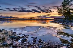 Melting (Peter Vestin) Tags: nikondf sigma24mmf14dghsmart siruin3204x siruik30x adobecreativecloudphotography topazlabscompletecollection skutberget karlstad vrmland sweden vnern nature landscape seascape sunset ice