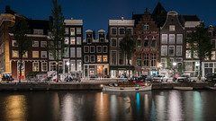 Amsterdam Nights (McQuaide Photography) Tags: amsterdam noordholland northholland netherlands nederland holland dutch europe sony a7rii ilce7rm2 alpha mirrorless 1635mm sonyzeiss zeiss variotessar fullframe mcquaidephotography adobe photoshop lightroom tripod manfrotto light licht night nightphotography nacht longexposure stad city capitalcity urban lowlight architecture outdoor outside old oud gracht grachtenpand canalhouse house huis huizen traditional authentic water reflection centrum gebouw building waterfront waterside canal boat boot windows herengracht travel traveldestination landmark skyline wideangle wideanglelens groothoek 169 widescreen panoramic