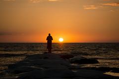 Staring at the sun.. (masowar (often off, sorry!!)) Tags: italia italy italie sicilia sicily agrigento panorama pano nikkor nikond800 tramonto sunset seascape sea spiaggia colors colori massimilianoacquisti massimilianoa masowar massimilianoacquisti couple sun whisper