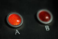 A versus B (Karen Carmen) Tags: a musictech b macro recordingstudio foothillcollege buttons circles red circular canon100mm light macromondays mystery blackbackground mysterious