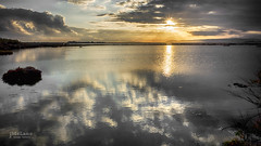 Sunset reflections (Jean McLane) Tags: sunset reflections reflects reflets reflejos water waterfront cloudy cloudscape