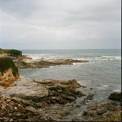 Rocks (davidgarciadorado) Tags: sea coast rocks waves clouds kodak ektar 120film 6x6 rolleiflex planar mediumformat film landscape