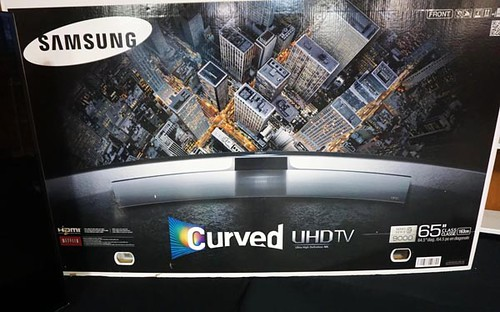 "Samsung 65"" 4D curved screen TV ($952.00)"