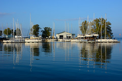 Harbour reflections (sarah_presh) Tags: blue sea usa holiday reflection water boats harbour roadtrip newyorkstate lakeontario masts sacketsharbor nikond7100