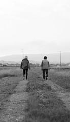 WALK WITH A FRIEND (sim_limited) Tags: walk friend friends oldage farmroad bothway blackandwhite filmcamera pentaxart pentaxlife pentaxawards pentaxflickraward