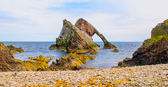 Bow Fiddle Rock (williamrandle) Tags: pebbles pebblebeach beach shore portknockie moray northeastscotland landscape seascape scotland 2016 holidays sea northseawater rugged sky clouds beauty nimkon d7100 tamron2470f28vc outdoor serene