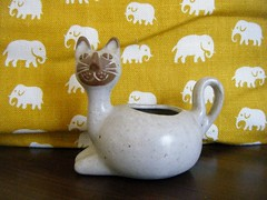 itty bitty kitty (fries in a cone) Tags: cat kitten stoneware pottery lions valley mcm david stewart josef frank elephants gold yellow sweden estrid ericson svenskt tenn