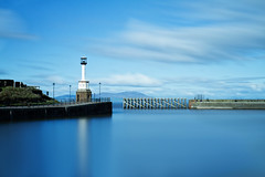 The gate keeper (Caleb4ever { ON VACATION }) Tags: caleb4ever lighthouse maryport sea cumbria coast blue gate longexposure le clouds water seascape landscape scenic scene harbor harbour sky