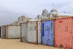 Container jungle (dorrisd) Tags: scheveningen containers beach endofseason clearing sand kurhaus architecture boulevard seafront coastal coastline container clear remove linedup bora strand beachlife kust nederland nederlands zuidholland southholland dutch mieneke dorrisd andeweg outdoors thehague denhaag condos flats apartments esplanade letters exteriors flag color colors colorful eindeseizoen sad moody atmosphere jungle mienekeandewegvanrijn lowangle photography colorimage