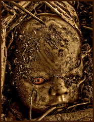 Chucky's Back (Vide Cor Meum Images) Tags: mac010665yahoocouk markcoleman markandrewcoleman videcormeumimages vide cor meum nikon d750 halloween all hallows chucky scare horror dolls doll buried abandoned toy toys scary discarded distressed disturbing seia selectivecolour