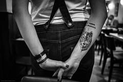 monsters (jrockar) Tags: streetphotography documentary photography street london bw mono blackandwhite tattoo girl woman sexy fit folded hands behind back jeans wolf monster human candid moment instant snap shot decisive x100s fuji prime lens standard rangefinder jrockar janrockar idiot ordinarymadness ordinary madness meme closeup detail