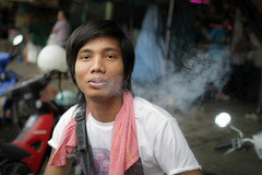 Krung Thep, the city of angels (fredcan) Tags: street travel portrait face pose asian thailand asia southeastasia market bangkok smoke smoking thai gaze youngman chatuchak krungthep thecityofangels fredcan