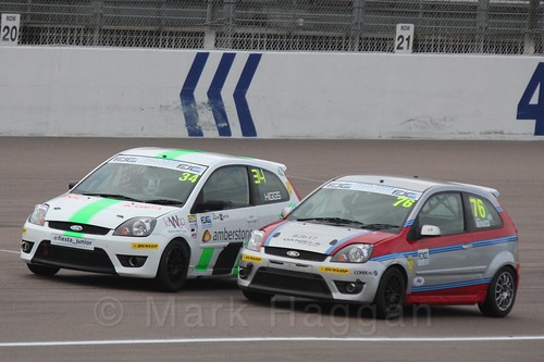 Carlito Miracco passes Michael Higgs in Race 2 at the BRSCC Fiesta Junior Championship, Rockingham, Sept 2015