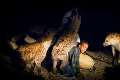 Hyena Street Food (departing(YYZ)) Tags: africa street travel portrait people animals child ethiopia harar sonnartfe55mmf18zalens