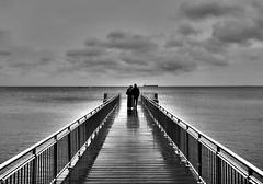 Romantic Walk (Bkutlak H.D) Tags: light shadow sea sky blackandwhite bw white black love water lines silhouette landscape long ship shadows angle walk wb minimal line romantic romantica