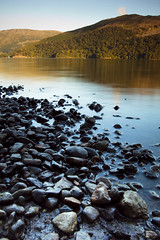Pebbles in the Lake (ben_thedriver) Tags: old autumn sunset summer england orange cloud sun colour reflection green film water grass rock clouds contrast canon walking landscape eos mirror golden landscapes early high still woods rocks warm raw quiet ripple lakedistrict sigma hills clear filter lee rest grad vignette goldenhour filmic waterscape constant ullswater filmlook constantlight splittoning ndgradfilter eos60d