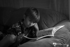 Connor Book-9493 B&W (Audrey R. Smith (NatureQuest)) Tags: boy reading cozy readingbylamplight relaxed bathrobe luxury easygoing boyreading boywithbook quietactivity
