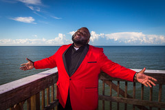"""""""Embracing The Light"""" (So Fluid) Tags: love red engagement photography portrait protraitphotography portraiture suit happy happiness embracing embrace beach fortmyers water fortmyersbeach man smile smiling smooth fresh clean clouds blue sky pier 17mm wideangle humans"""