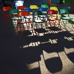 cohort of color (weltreisender2000) Tags: multicolored metal folding chairs cohort shadows farmers market pavilion memphis tennessee
