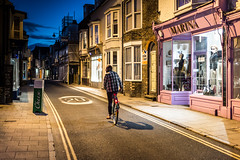 Cheesy Moments (Sean Batten) Tags: whitstable england unitedkingdom gb kent night nighttime streetphotography street city urban cyclist road pavement shops harbourstreet
