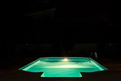 Nightpool (The_Kevster) Tags: 2016 cyprus leica rangefinder leicam9 summicron50mm night nightshot pool swimmingpool water reflections light green blue dark ripples