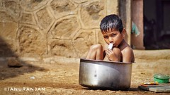 The Bath in Tub (ianuranjan) Tags: child bath bathtub cookingvessel maharashtra india indian kid boy