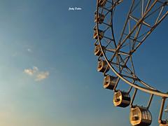 revolving wheel... (Jinky Dabon) Tags: fujifilmfinepixhs35exr ferriswheel wheel amusementpark ride funfair