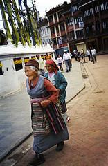 Woman circumambulates the Bodhnath Stupa in Bodhanth, Bagmati, Nepal